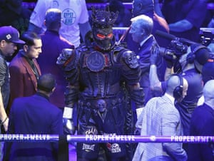Deontay Wilder enters the ring in his spectacular outfit.
