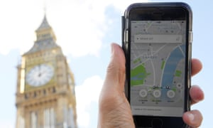 A photo illustration shows the Uber app on a mobile telephone, as it is held up for a posed photograph in central London.