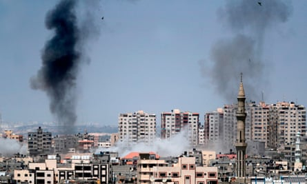 Smoke billowing from buildings after an Israeli airstrike on the Gaza Strip