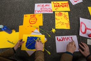 Activists decorate King's College London with flowers and signs calling for divestment from fossil fuels.