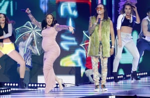Cardi B performs with La Modelo with Ozuna at the Billboard Latin Music awards in April.