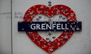 A tribute hangs from a hoarding surrounding Grenfell Tower
