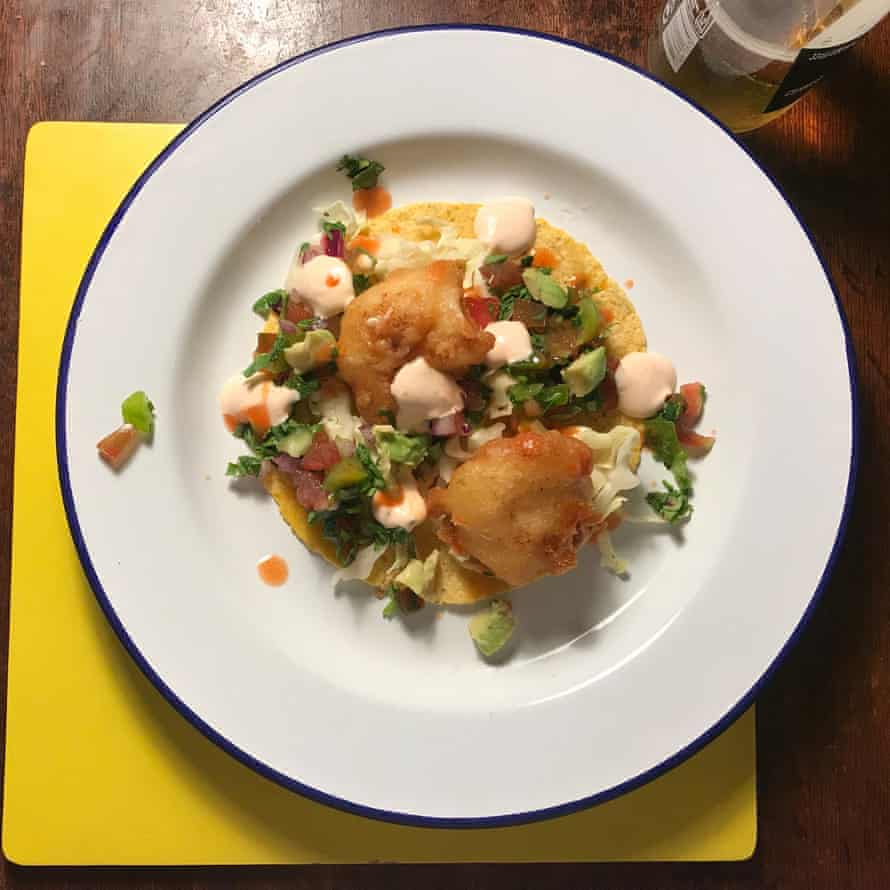 Fill the tacos with the cabbage, fish, salsa, chilli soured cream and avocado and tuck in.