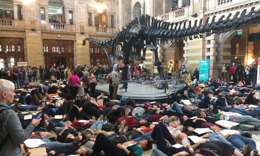 About 300 protesters lay beneath Dippy the dinosaur at Kelvingrove art gallery and museum in Glasgow.