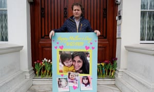 Richard Ratcliffe delivers a Mother's Day card and flowers to the Iranian embassy