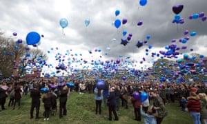 People release balloons outside Alder Hey children's hospital.