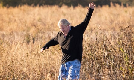 Boris Johnson waves at photographers as he runs near his Oxfordshire home.