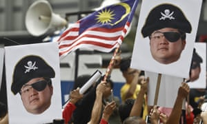 Protesters hold portraits of Jho Low, who was charged with money laundering on Thursday, during a protest in Kuala Lumpur, Malaysia, on 14 April.