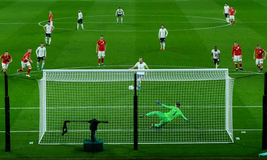 Harry Kane converts a penalty against Poland.