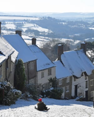 A toboggan steers down Gold Hill in Shaftesbury, Dorset, on Saturday.