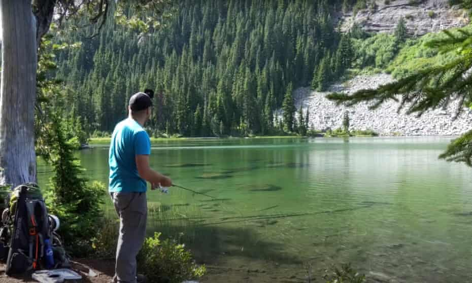 Fishing in a perfect shallow, clear lake for trout.