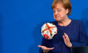 Angela Merkel with a handball