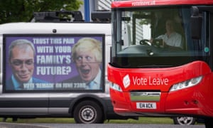 The Vote Leave campaign bus passes a Vote Remain poster featuring Nigel Farage and Boris Johnson in Accrington.