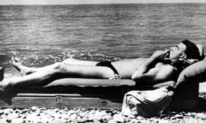 Cambridge-educated Russian spy Guy Burgess relaxes on the shores of the Black Sea. Photograph: Popperfoto/Getty Images