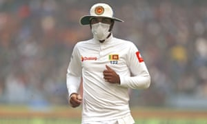 Sri Lanka's captain Dinesh Chandimal fields in a mask.