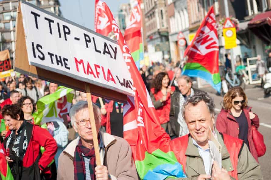 Banners reading 'TTIP play is the Mafia way' in a protest in Amsterdam, October 2015.