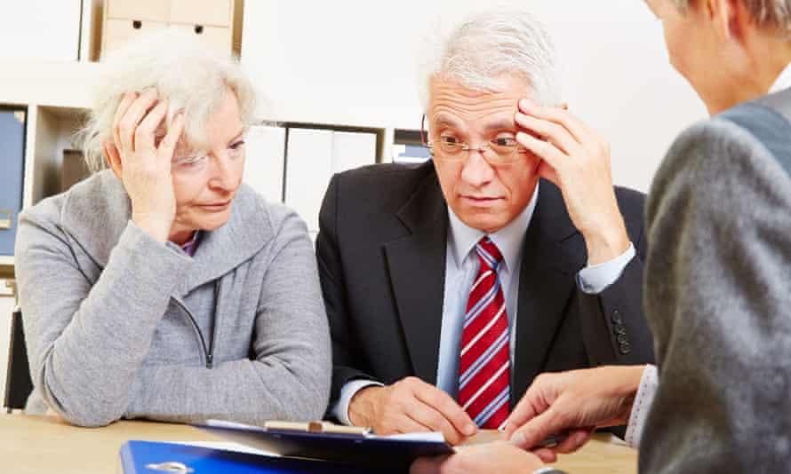 senior couple with retirement advisor