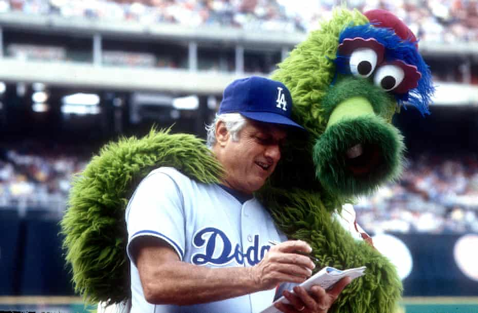 Phillie Phanatic gives LA Dodgers manager Tommy Lasorda a hug.