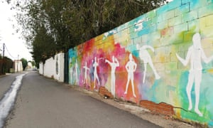 Murals painted by the community with help from local street artists such as Boa Mistura.