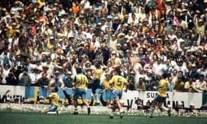 Jairzinho slides on to his knees as his team-mates rush to join him.