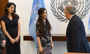 The UN secretary-general, António Guterres, and Yazidi activist Nadia Murad speak as Amal Clooney looks on at the United Nations Headquarters in New York.