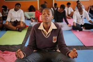 Children meditate in class