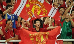 Manchester United fans wait for the start of a friendly against Shanghai Shenhua in the Chinese city in 2012.