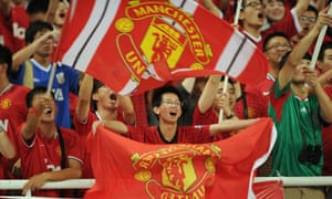 Local Manchester United fans wait for the start of a match against Shanghai Shenhua