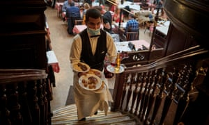 A waiter at the Chartier Bouillon restaurant near Grands Boulevards in Paris, France.