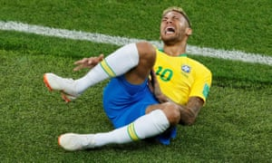 Neymar writhes on the ground after clashing with Miguel Layún.