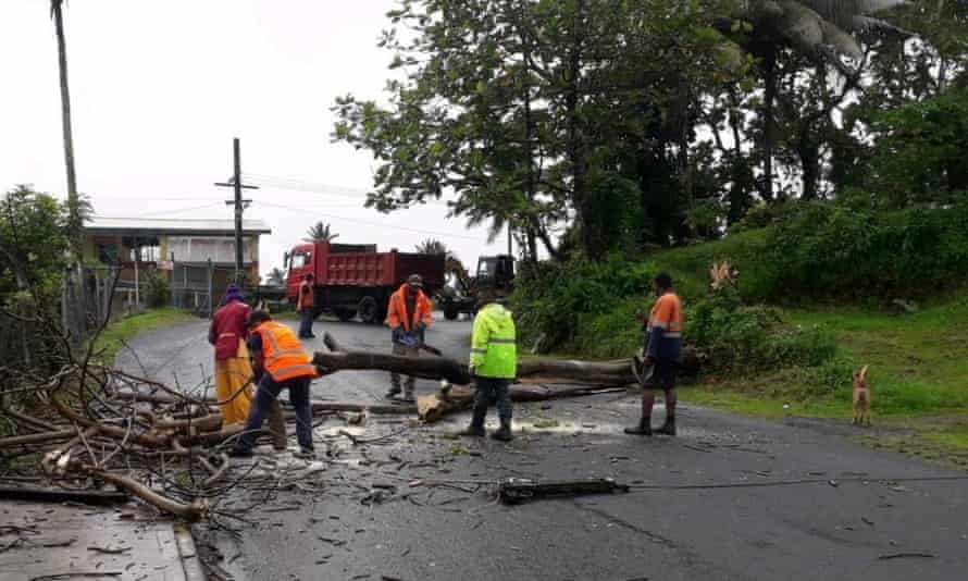 People remove debris due to Cyclone Yasa at Velau Drive in Fiji, December 18, 2020, in this image obtained via social media. Fiji Roads Authority via REUTERS ATTENTION EDITORS - THIS IMAGE HAS BEEN SUPPLIED BY A THIRD PARTY. MANDATORY CREDIT. NO RESALES. NO ARCHIVES.