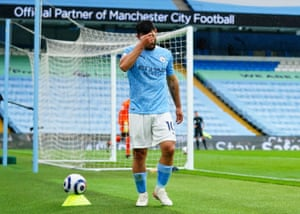 Sergio Aguero of Manchester City holds his head as he is substituted.