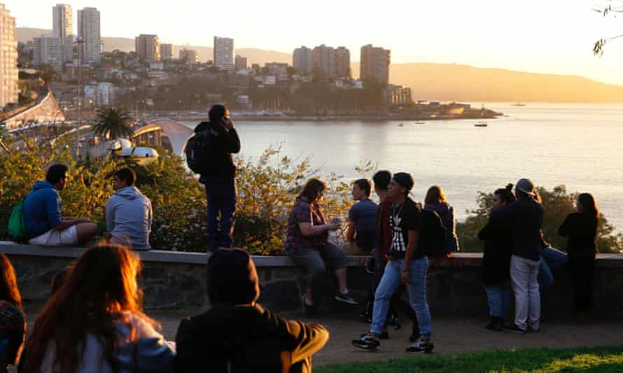 People look out towards the ocean on Cerro Castillo hill, after a mass evacuation of the entire coastline during a tsunami alert after a magnitude 7.1 earthquake hit off the coast in Vina del Mar, Chile.