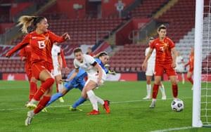 Ellen White of England looks on as Julija Zivikj of North Macedonia scores an own goal.
