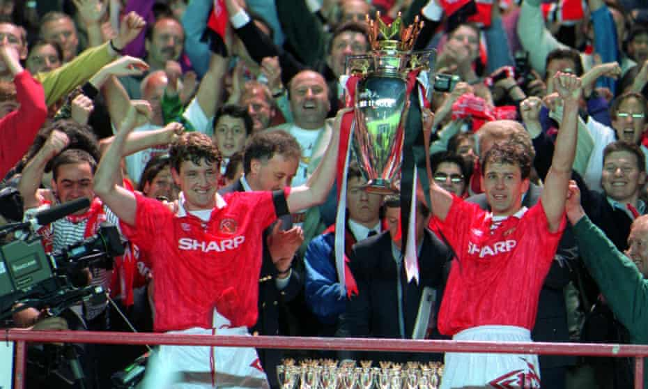 Manc3hster United's Steve Bruce, left, and Bryon Robson lift the new Premier league trophy at the end of the inaugural 1992-1903 season.