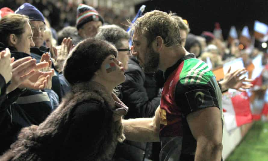 Robshaw celebrates victory on his 200th appearance for Quins, in 2014, with a kiss from Camilla Kerslake.