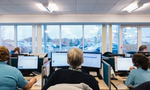 Call handlers and clinicians an NHS 111 call centre in Ashford, Kent.