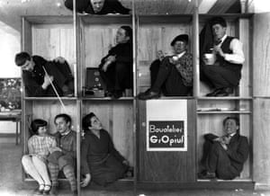Bauhaus director Walter Gropius's students poke fun at his minimalist design for living ideas in this 1927 photograph by Edward Curtis.
