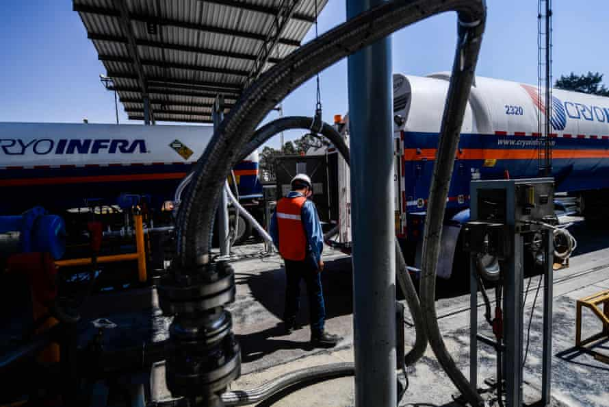 A worker fills a tanker with medicinal oxygen at the Infra Group factory in San Miguel Xoxtla, Puebla, Mexico, March 2021