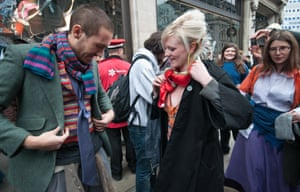 London group Space Hijackers approach shoppers on Oxford St in a swap don't shop event.