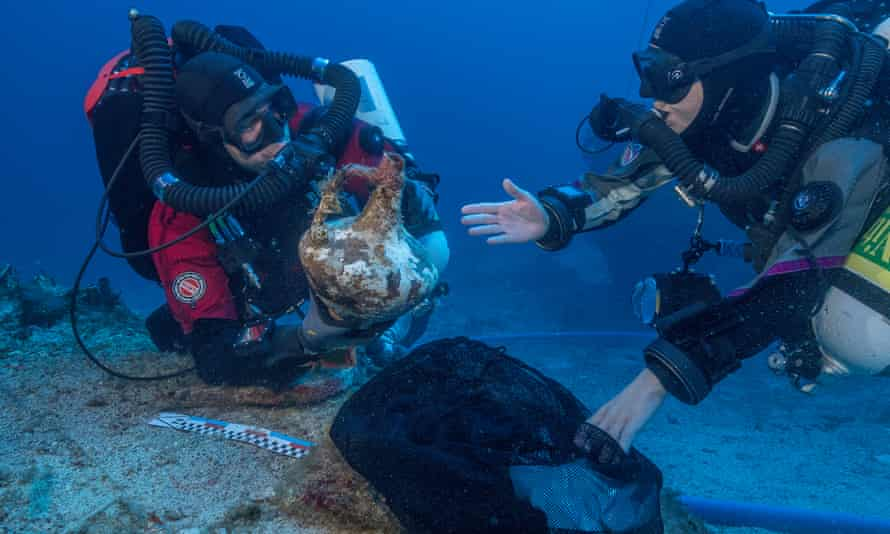 As well as the arm, divers have recovered a patterned slab of red marble the size of a tea tray, a silver tankard, sections of joined wood from the ship's frame and a human bone. Photograph: Brett Seymour/EUA/ARGO 2017