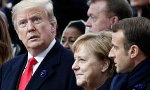 A surprised Trump next to Angela Merkel.
