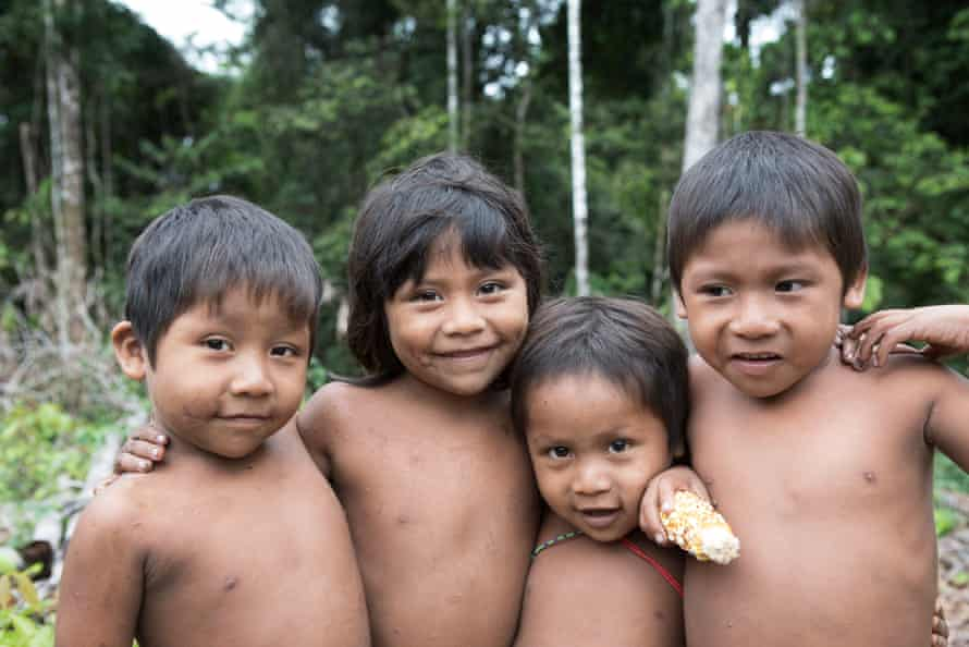 Young Korubo children (from left) Tamo Lala, Tupa, Tëpi and Visa are seen on the Amazonian Indigenous reserve of Vale do Javeri