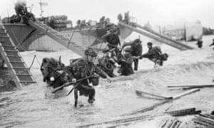 The fourth special service brigade makes its way onto Juno beach at Saint-Aubin-sur-Mer on the morning of 6 June 1944.