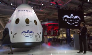 Elon Musk with a SpaceX Dragon V2 spacecraft