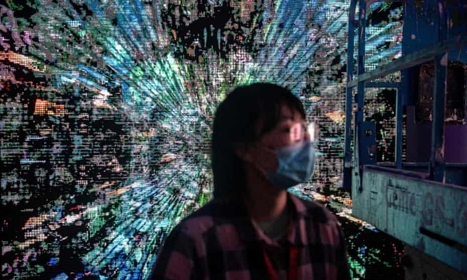 A visitor at a cryptoart exhibition, one of the world's first physical museum shows of blockchain art, at Beijing's UCCA Lab.