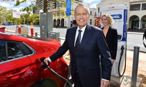 Bill Shorten charges an electric car after launching Labor's climate change policy in Canberra on Monday