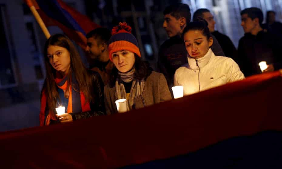 People march with an Armenian flag during a rally in Stepanakert.
