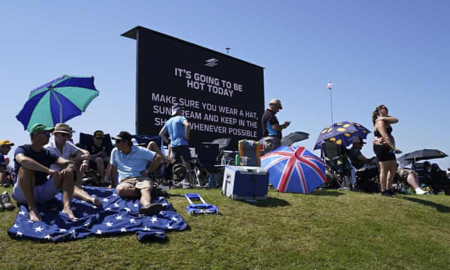 A video screen displays a hot weather warning at the British Grand Prix in Silverstone, England, on Sunday