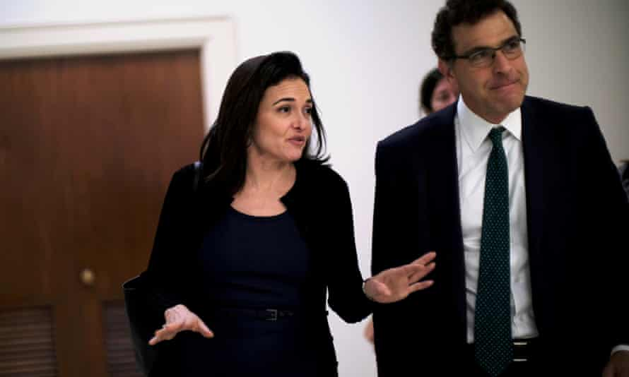 Sheryl Sandberg and Elliot Schrage, the outgoing head of communications and policy, in Washington.